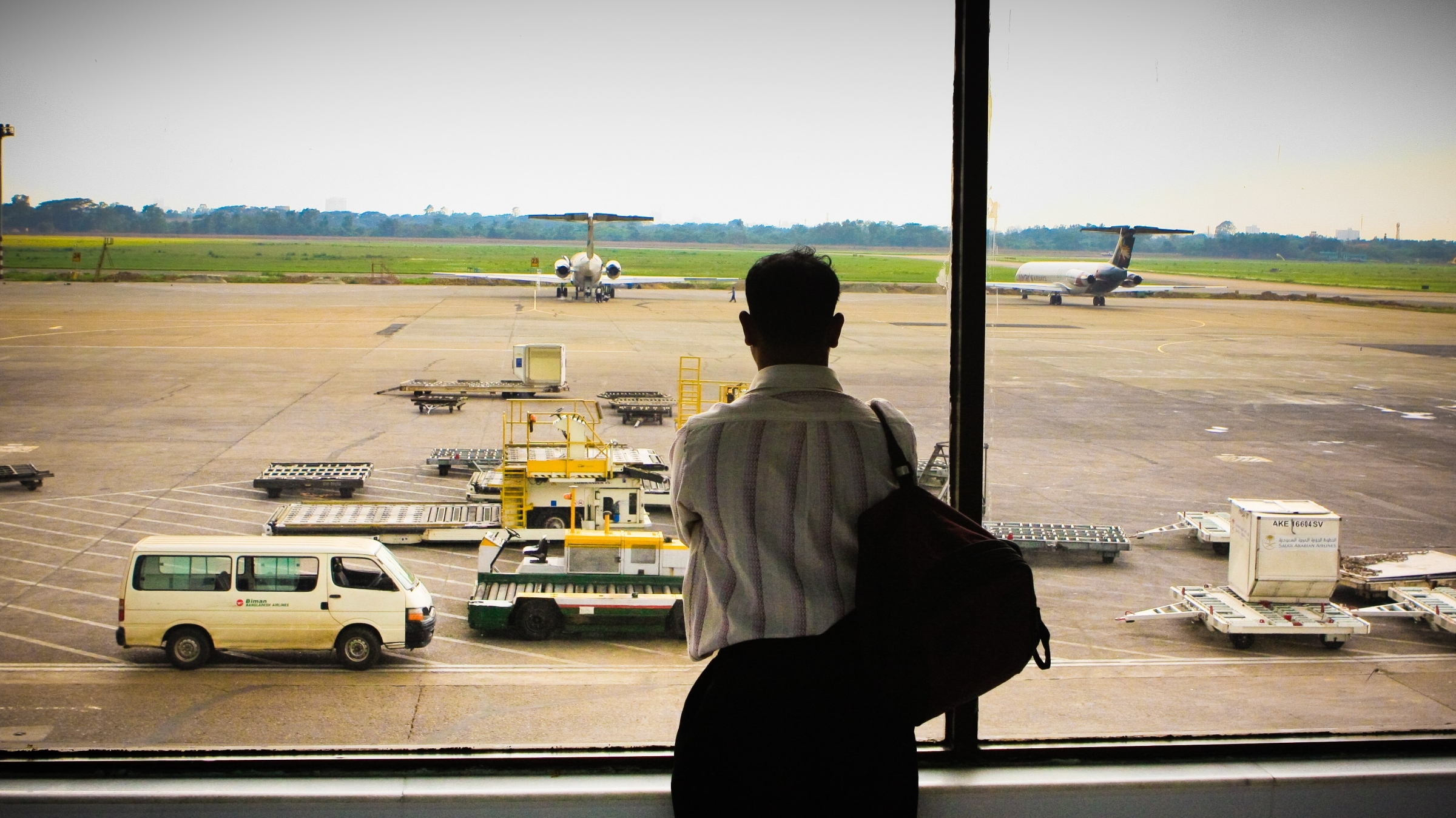 man awaits airplane