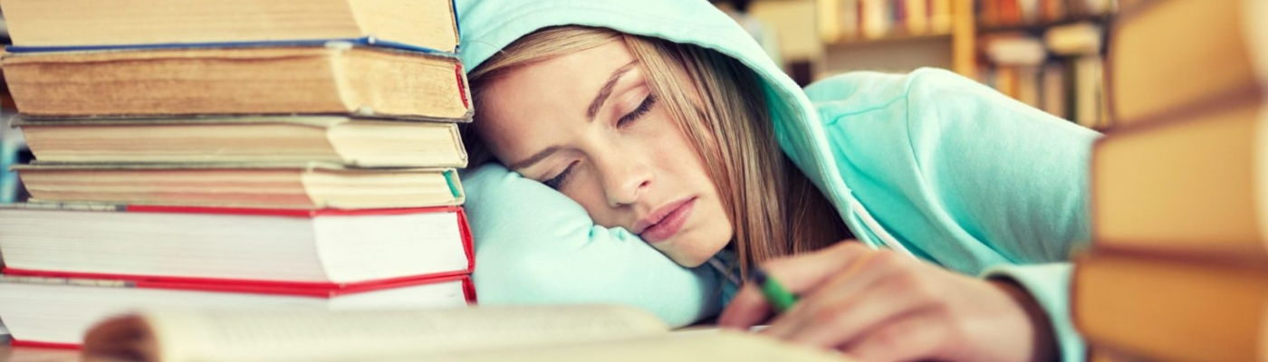 woman sleeping in library
